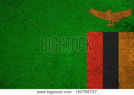 Zambia Flag On An Old Grunge Background