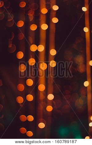 Night city lights bokeh background,Festive background with natural bokeh and bright golden lights.