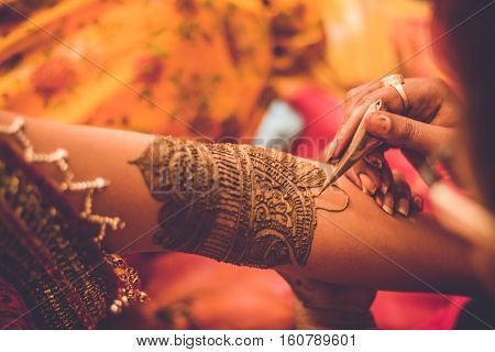 Indian Bride in the occasion of a wedding ceremony in an event Mehandi.