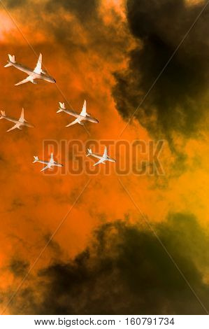 Squadron of commercial airplanes in flights over orange tempest clouds trying to avoid collision