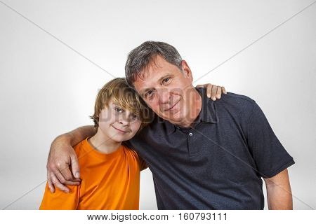 happy father and son hugging isolated on white