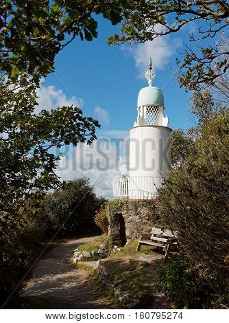 The lighthouse at Portmeirion is located close to the beach on one of the many waymarked walks in the woods.