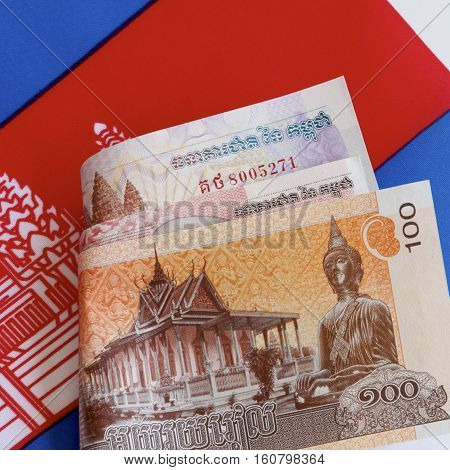 Cambodian riel currency and the Cambodian flag.