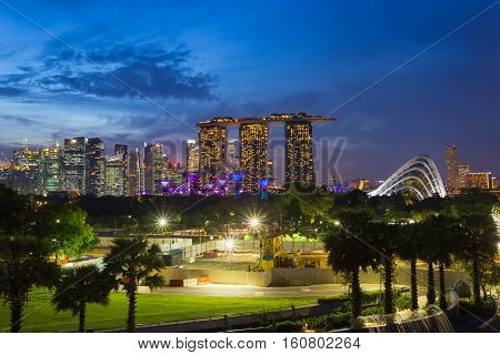 SINGAPORE - NOV 19 2016 : Marina Bay Sands Hotel and Garden by the Bay and singapore flyer it is Symbol or Landmark of Singapore most popular for tourist in twilight time on November 192016