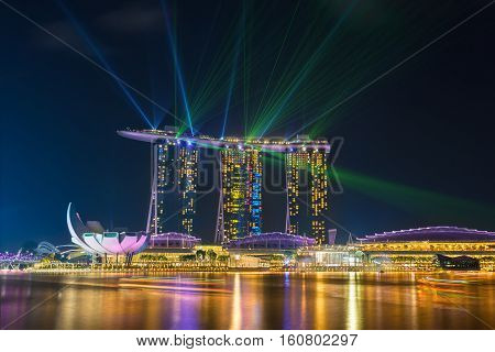 SINGAPORE - NOV 18 2016 : Beautiful laser show at Marina Bay Sands Hotel in night time is most popular for tourist and landmark center of Singapore city on November 18 2016