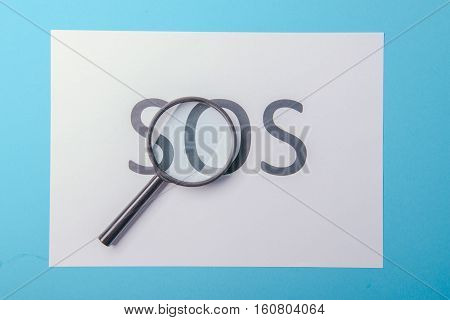 Word Sos Written On Paper