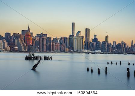 Midtown Manhattan from the east river early morning with a long exposure
