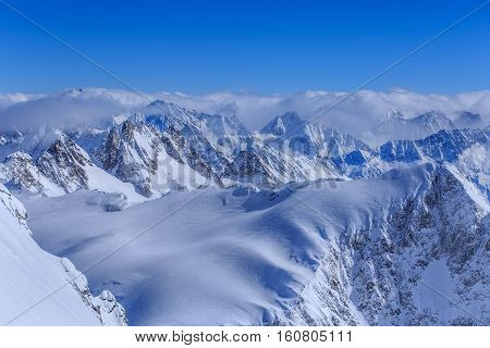 Alps, view from Mt. Titlis in winter. Titlis is a mountain located on the border between the Swiss Cantons of Obwalden and Bern.