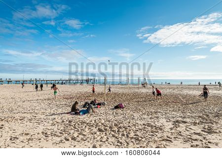 Adelaide Australia - August 16 2015: People playing volleyball at Glenelg Beach on a warm sunny day.