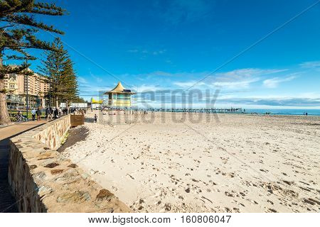 Adelaide Australia - August 16 2015: People walking along Glenelg Beach on a bright day