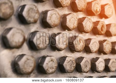 bolts and nuts in machinery for repair and service which old condition. damage of bolts and nuts of machine equipment. Industry background with many bolts and nuts in workshop for maintenance.