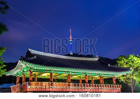 Namsangol Hannok Village And Seoul Tower Located On Namsan Mountain At Night In Seoul,south Korea.