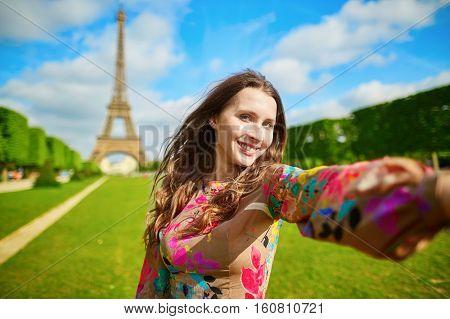 Woman Tourist At Eiffel Tower Making Travel Selfie