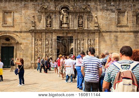 SANTIAGO SPAIN - AUGUST 16: Pilgrimns of the way of St. James waiting at the entrance of the cathedral on August 16 2016