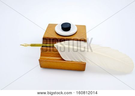 Feather Pen In A Inkwell