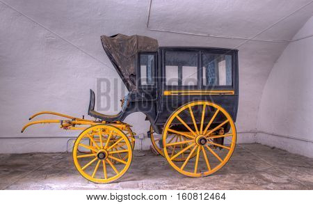 View of ancient black and yellow carriage