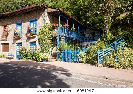 View of rustic house with blue windows in Spain