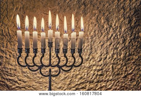 Jewish menorah with candles is traditional symbol for Hanukkah Holiday