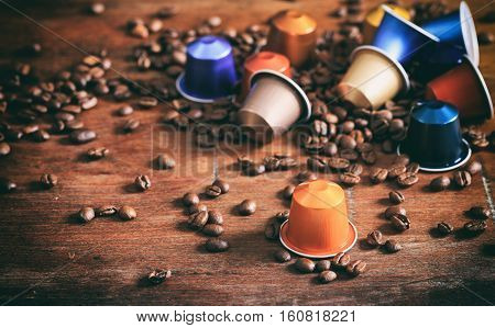 Colorful Espresso Capsules On Wooden Background