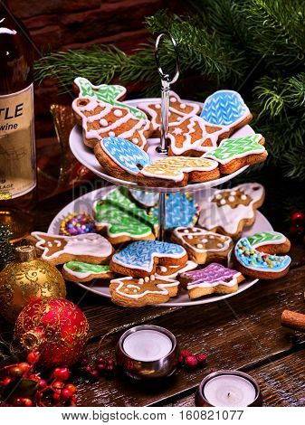 Beautiful colorful cookies on Tiered Cookie Stand. Close-up. Decorated Christmas tree background.