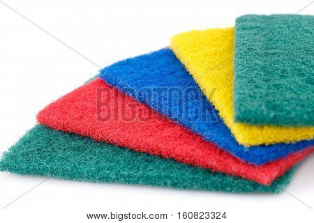 Pan scourers isolated on white background, close up picture.