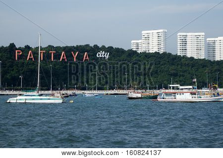 Pattaya Bay With Commerical Boats And The Pattaya City Sign