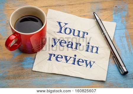 Your year in review  - handwriting on a napkin with a cup of espresso coffee