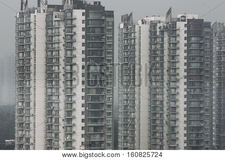 pattern of crowded residential towers and high housing density in beijing