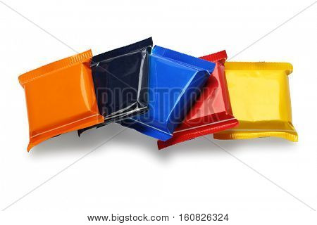 Row of Chocolate Bars In Colorful Plastic Wrappers on White Background