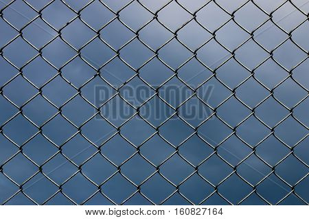 Wired fence on a sky and cloud background.