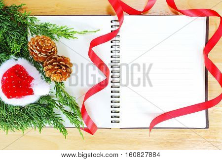 note book and ribbon on wood background.New year background.