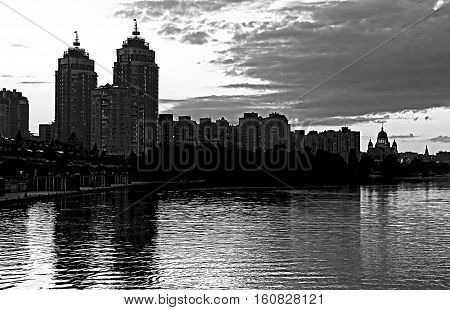 Obolon embankment of the Dnieper River in Kyiv in the evening, Ukraine (black and white)