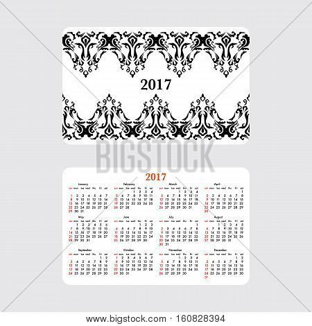 Horizontal pocket calendar for 2017 year. Week starts Sunday. Double-sided calendar for 2017 year. Yearly calendar template with text 2017 and damask classic pattern.