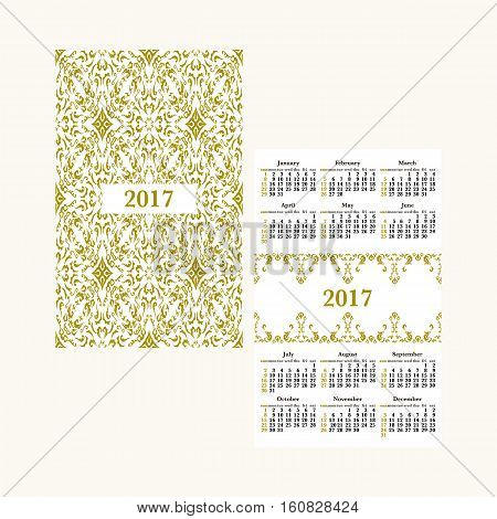 Vertical pocket calendar for 2017 year. Week starts Sunday. Double-sided calendar for 2017 year. Yearly calendar template with text 2017 and damask classic pattern.