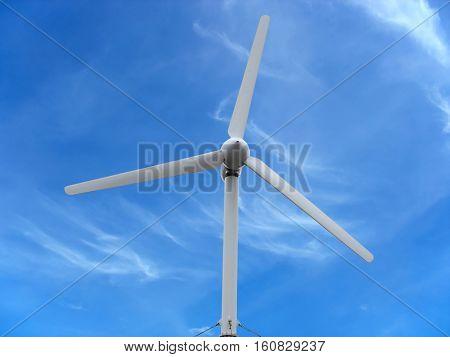 Renewable Energy Concept Wind Turbine Over Blue Sky Background