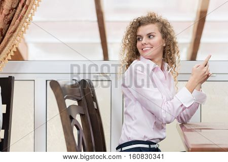 Business Woman Turning Back Chatting Cell Phone Messaging, Happy Smiling Young Beautiful Girl Sit On Table Restaurant Interior
