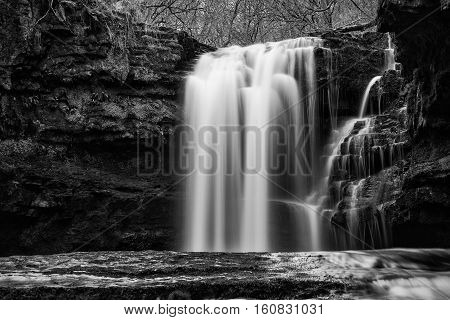 Beautiful Black And White Waterfall Landscape Image In Forest During Autumn Fall In Wales Uk