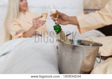 Young Couple Lying In Hotel Bed Drink Champange, Happy Man And Woman Lovers In Bedroom