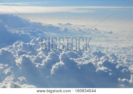 Sky scenery. Aerial view over the cumulus clouds on a sunny day.
