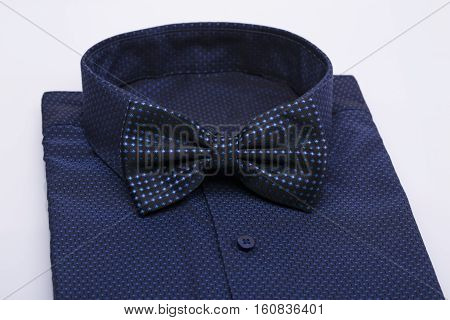 blue bow tie on a blue shirt, white background