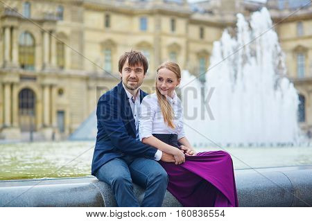 Beautiful Couple Having A Date In Palais Royal In Paris