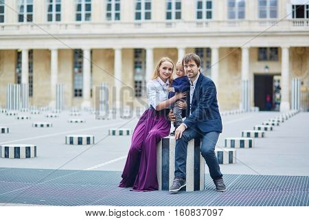 Happy Family Of Three In Palais Royal In Paris