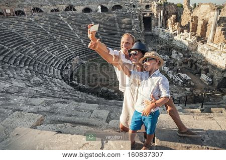 Family vacation selfie photo in antique amphitheater ruins in Side Turkey