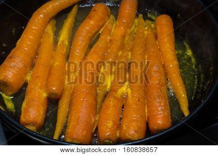 Carrots Being Glazed In Orange Juice.
