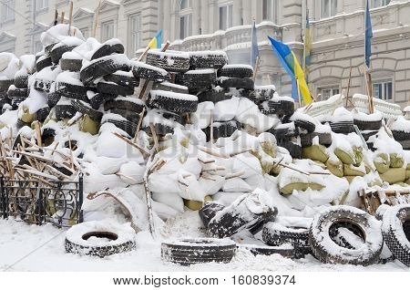 LVIV UKRAINE - JANUARY 26: Barricades of tires in the center of Lviv during the Maidan-2014 on January 26 2014 in Lvov Ukraine