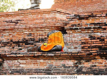 Ancient buddha statue at Mahathat temple that is historic site in Ayuttaya provinceThailand.