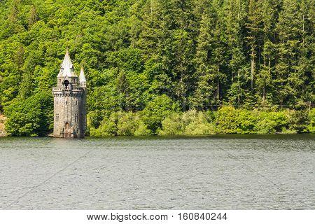 Gothic straining tower on Lake Vyrnwy reservoir. Powys Wales United Kingdom.