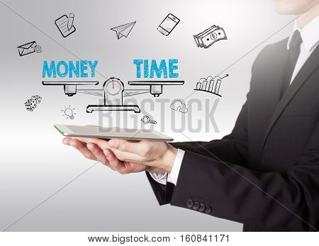 Money and Time Balance, young man holding a tablet computer