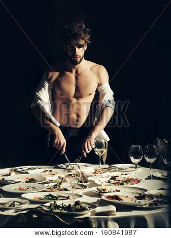 Handsome Man Stands At Table