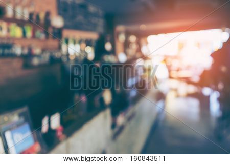 Blurred or Defocus image of Coffee Shop or Cafeteria for use as Background with vintage tone.